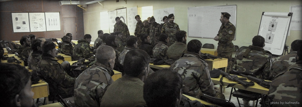 A trainer gives a motivational speech to Afghan soldiers in the NATO weapons training classroom.